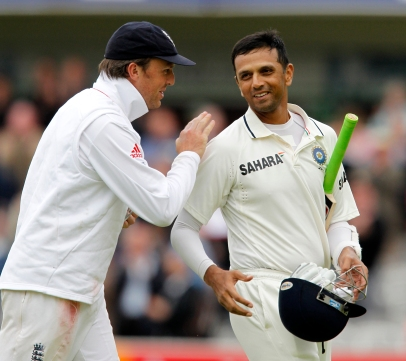 India's Rahul Dravid (R) is congratulated by England's Graeme Swann after finishing the 103 innings not out during Day 3 of the first Test match at Lord's Cricket Ground in London, on July 23, 2011. AFP PHOTO / IAN KINGTON RESTRICTED TO EDITORIAL USE. NO ASSOCIATION WITH DIRECT COMPETITOR OF SPONSOR, PARTNER, OR SUPPLIER OF THE ECB